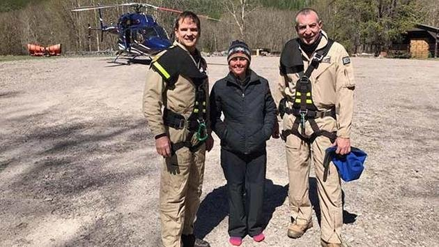 Madeline Connelly with rescuers (Mike Goguen/Two Bear Air Rescue)