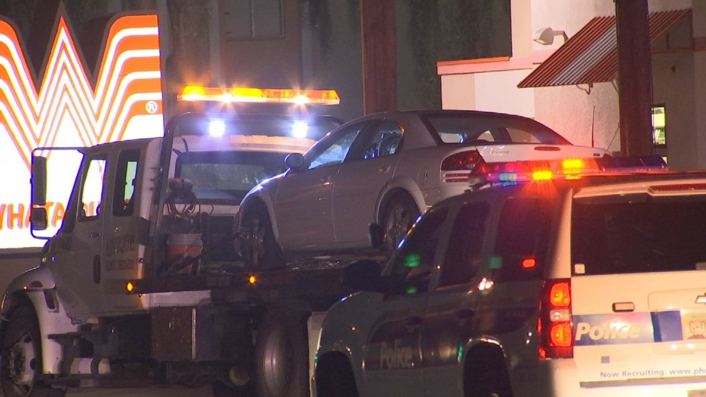 The car involved in the robberies being towed away (SOURCE: 3TV/CBS 5)