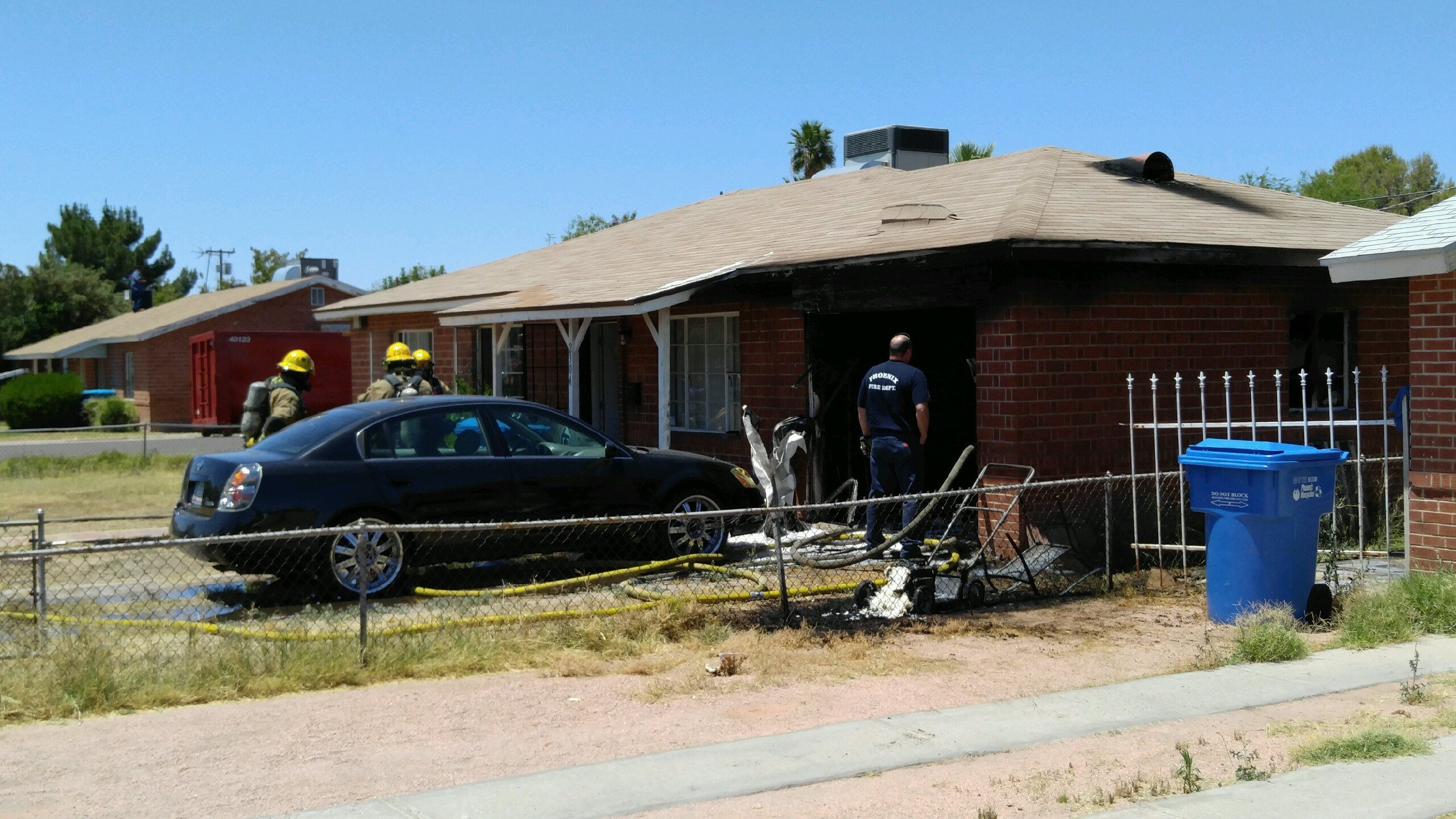 Fire crews put out a fire at a home near 24th street and Indian School Rd. (13 May 2017) [Source: 3TV/CBS5]