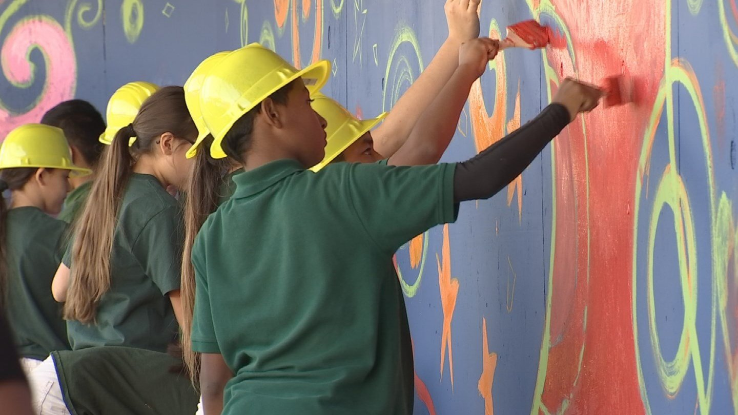 Students help paint a temporary walkway at Banner Medical Center. (Source: 3TV/CBS 5)