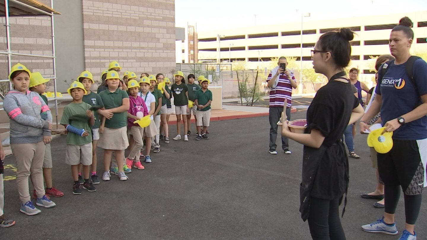 Students helped hand paint a temporary walkway at Banner University Medical Center Phoenix. (Source: 3TV/CBS 5)