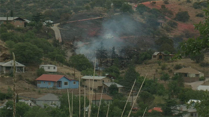 The brush fire that burned several buildings in Old Bisbee is contained. (Source: CNN)