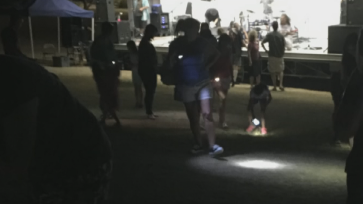 50 to 100 people with cell phone lights were on the prowl looking for the diamond after the concert. (Source: 3TV/CBS 5)