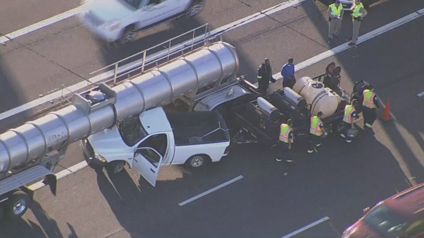 A pickup truck ended up pinned underneath a tanker early Wednesday morning. (Source: 3TV/CBS 5)