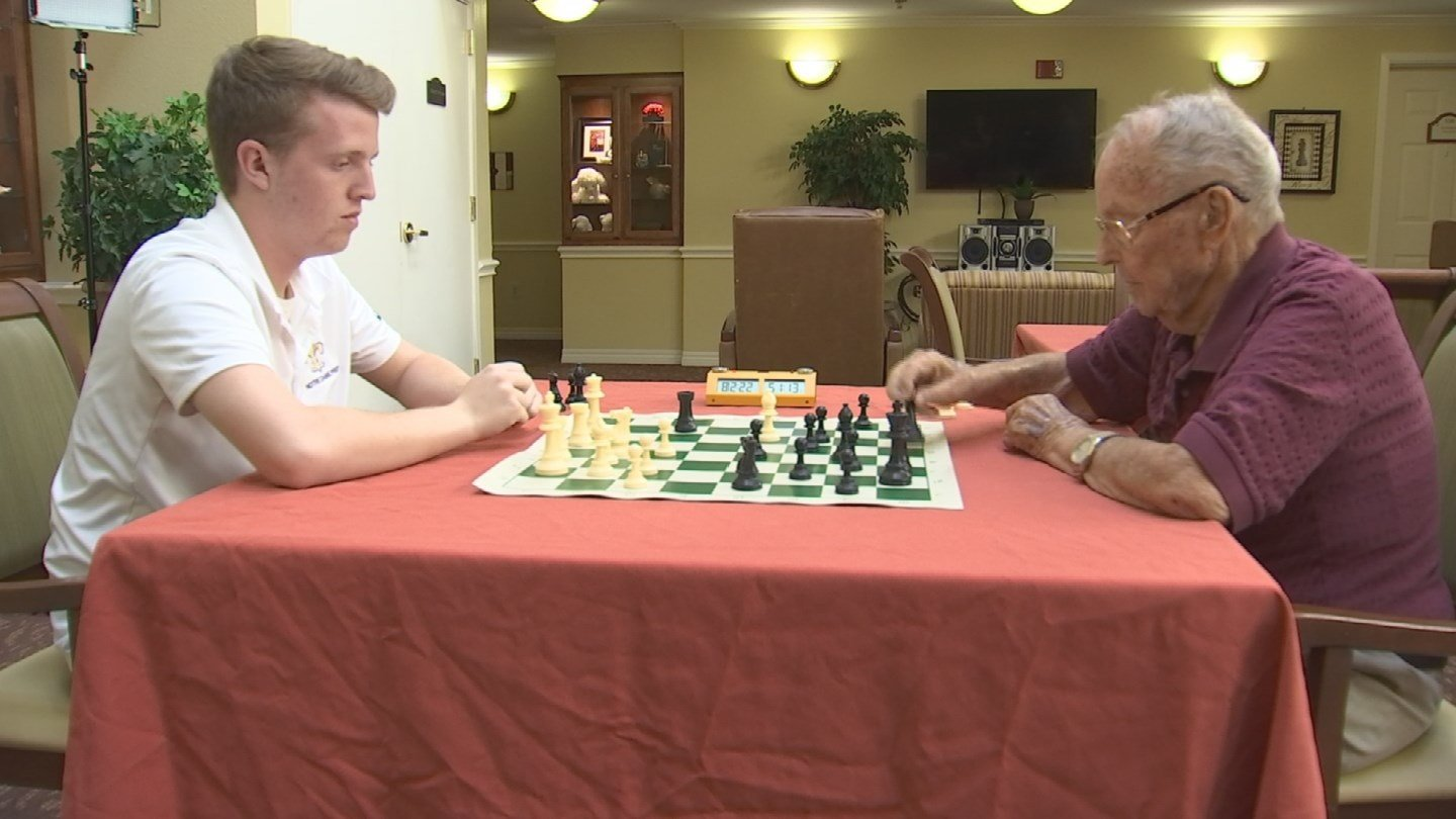 Thomas Meeks and Glenn Wood face off over the chess board. (Source: 3TV/CBS 5)