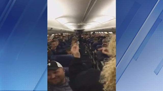 A high school choir from Scottsdale sang on a plane. (Source: 3TV/CBS 5)