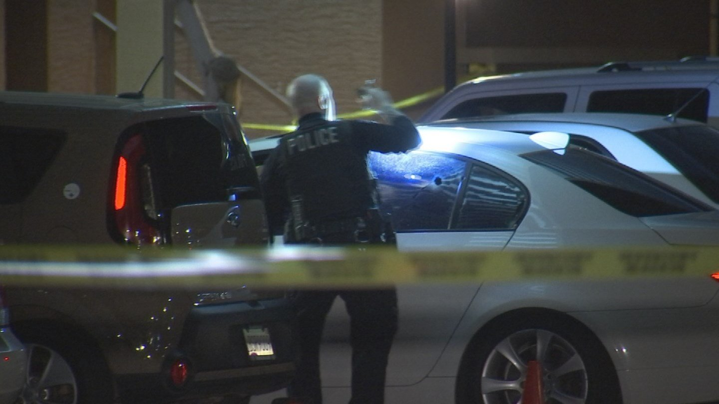 A Tempe police officer looking at a car involved in the deadly shooting. (Source: 3TV/CBS 5)