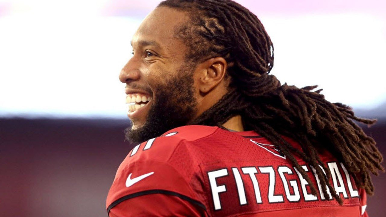 Sticking around: Larry Fitzgerald will play for the Cardinals next season