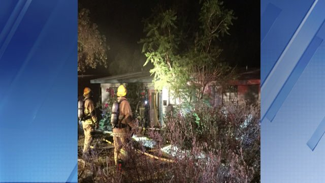 Phoenix firefighters at the scene of the house fire. (PHOENIX FIRE)