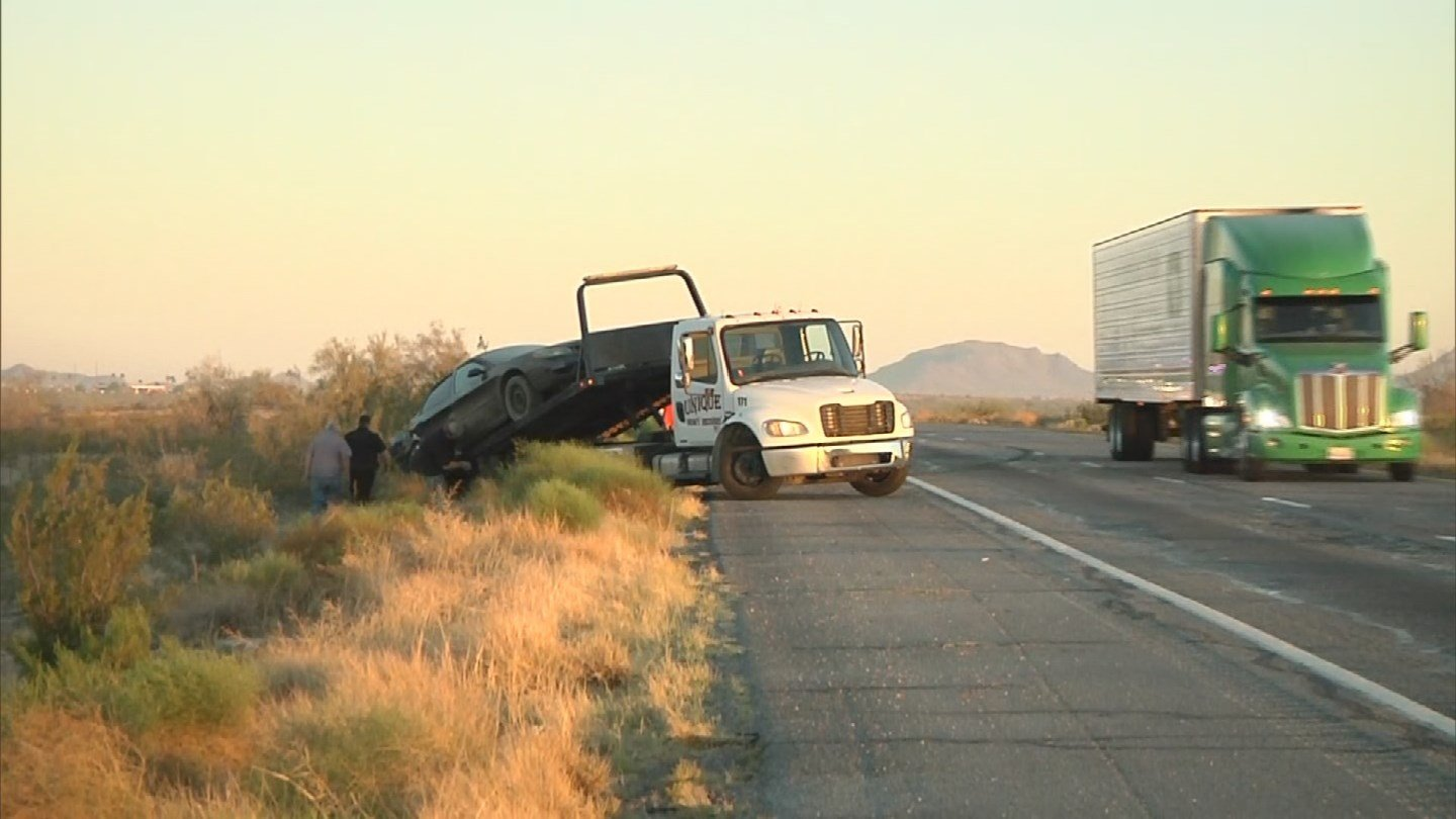 Tow truck taking a car away following a crash at I-10 (SOURCE: 3TV/ CBS 5)