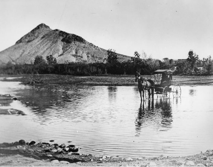 Horse and buggy crosses the Salt River around 1870. (Source: Tempe Historical Society)