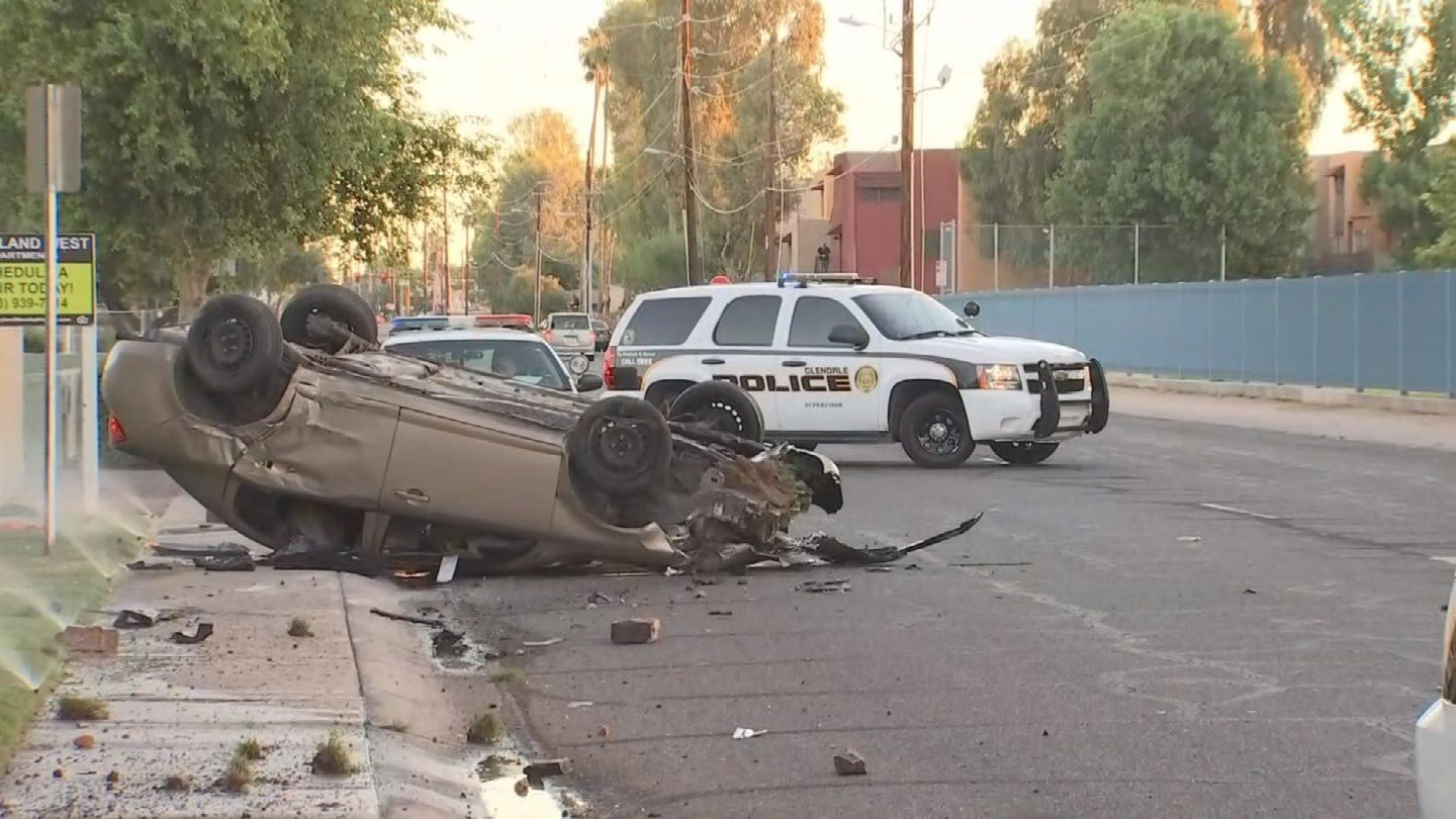 Glendale Police say the driver of this car hit a sign and a fire hydrant before leaving the scene. (SOURCE: 3TV and CBS 5)
