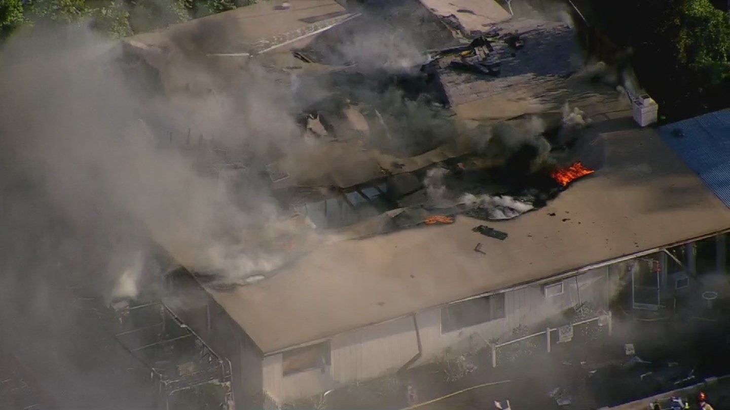 Firefighters battled a blaze that started in an RV and spread to a house in Mesa. (Source: 3TV/CBS 5)