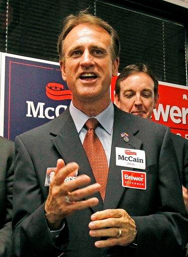 FILE- In this Aug. 26, 2010, file photo, Republican candidate for Corporation Commission Gary Pierce, campaigns with other Republican candidates in Phoenix. (Source: AP Photo/Ross D. Franklin, File)