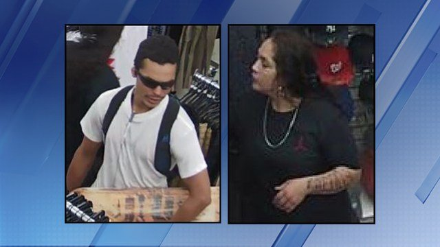 A man and a woman were suspected of robbing a clothing store in Phoenix on May 12. (Source: Silent Witness)
