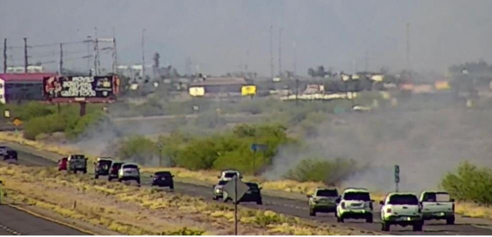 Firefighters were responding to a brush fire Sunday along SR 347 near Chandler. (Source: Arizona Department of Transportation)