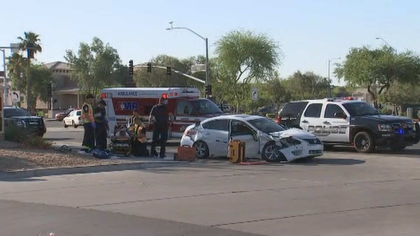 A three-vehicle collision caused a rollover in Surprise. (Source: 3TV/CBS 5)