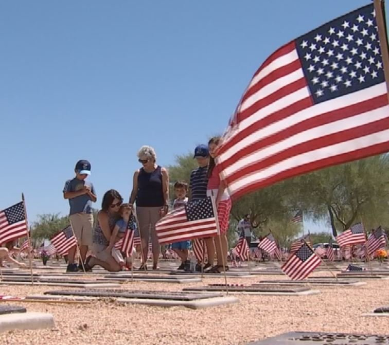 Famlies paying respect to loved ones on Memorial Day. (29 May 2017) [Source: 3TV/CBS5]