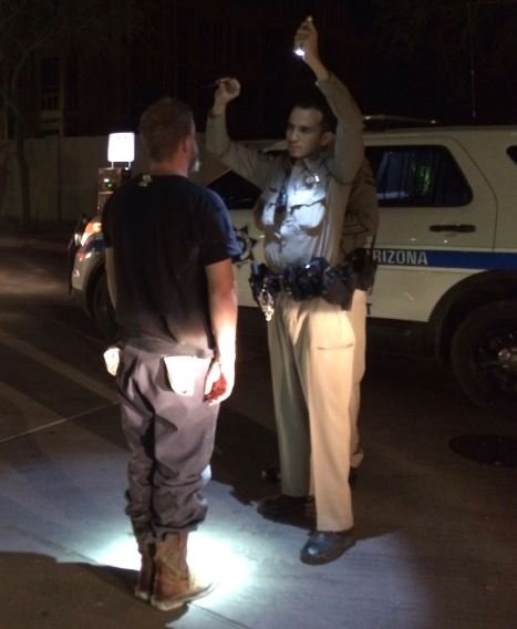 DPS officers conducting sobriety test on wrong-way driver from US60 Monday. (29 May 2017) [Source: Arizona Department of Public Safety]