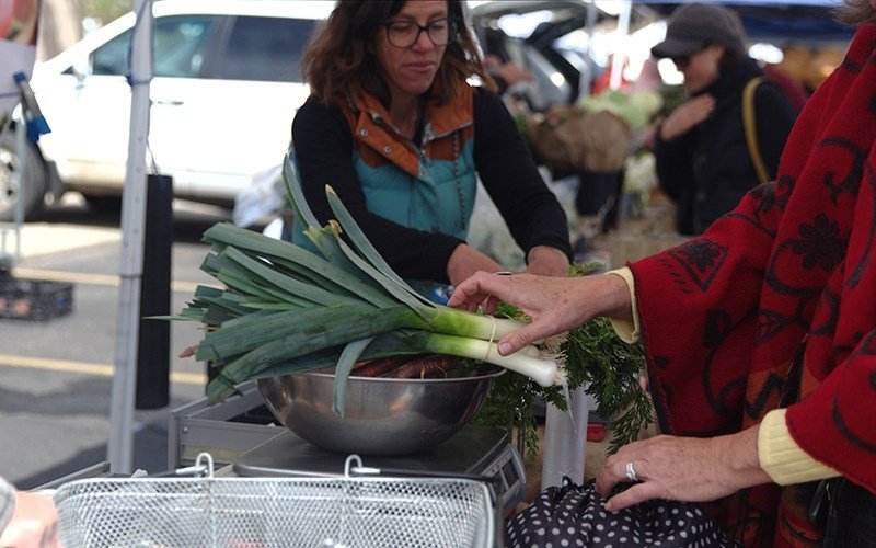 Shanti Rade, the co-owner of Whipstone Farm, sells goods at the Prescott market. (Source: Chelsea Shannon/Cronkite News)