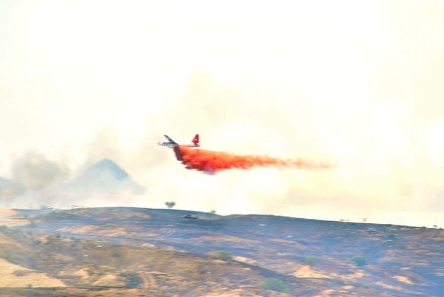 Aerial tanker planes were called in to drop retardant on the fire. (Source: Arizona Department of Forestry and Fire Management)