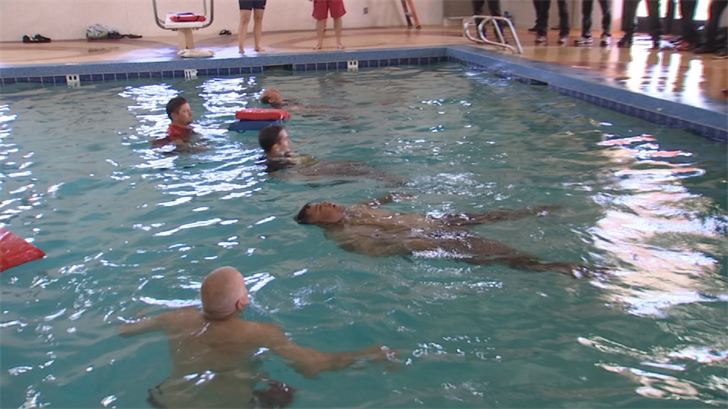 Emergency service personnel went into the pool with all their gear on as part of training. (Source: 3TV/CBS 5)
