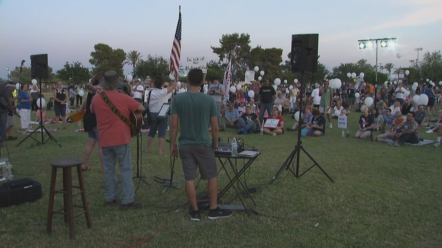 Dozens gathered at a rally held in Paradise Valley on Saturday calling for transparency from President Donald Trump's administration. (Source: 3TV/CBS 5)