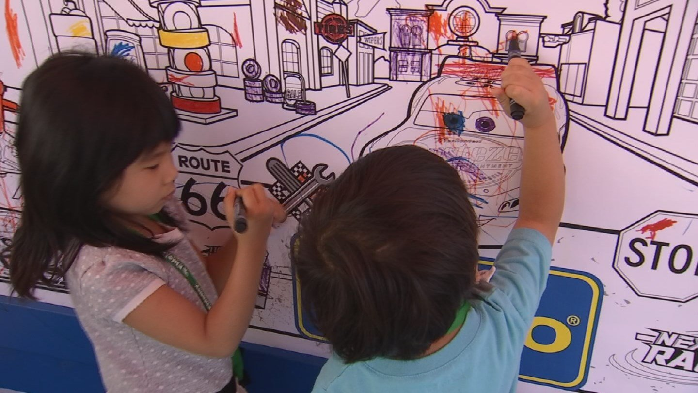 Kids were able to color a mural of characters from the movie. (Source: 3TV/CBS 5)