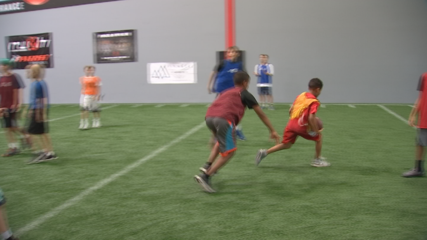 Monday morning, kids and teens took advantage of the air conditioning at the indoor training facility while playing football, lifting weights and running sprints. (Source: 3TV/CBS 5)