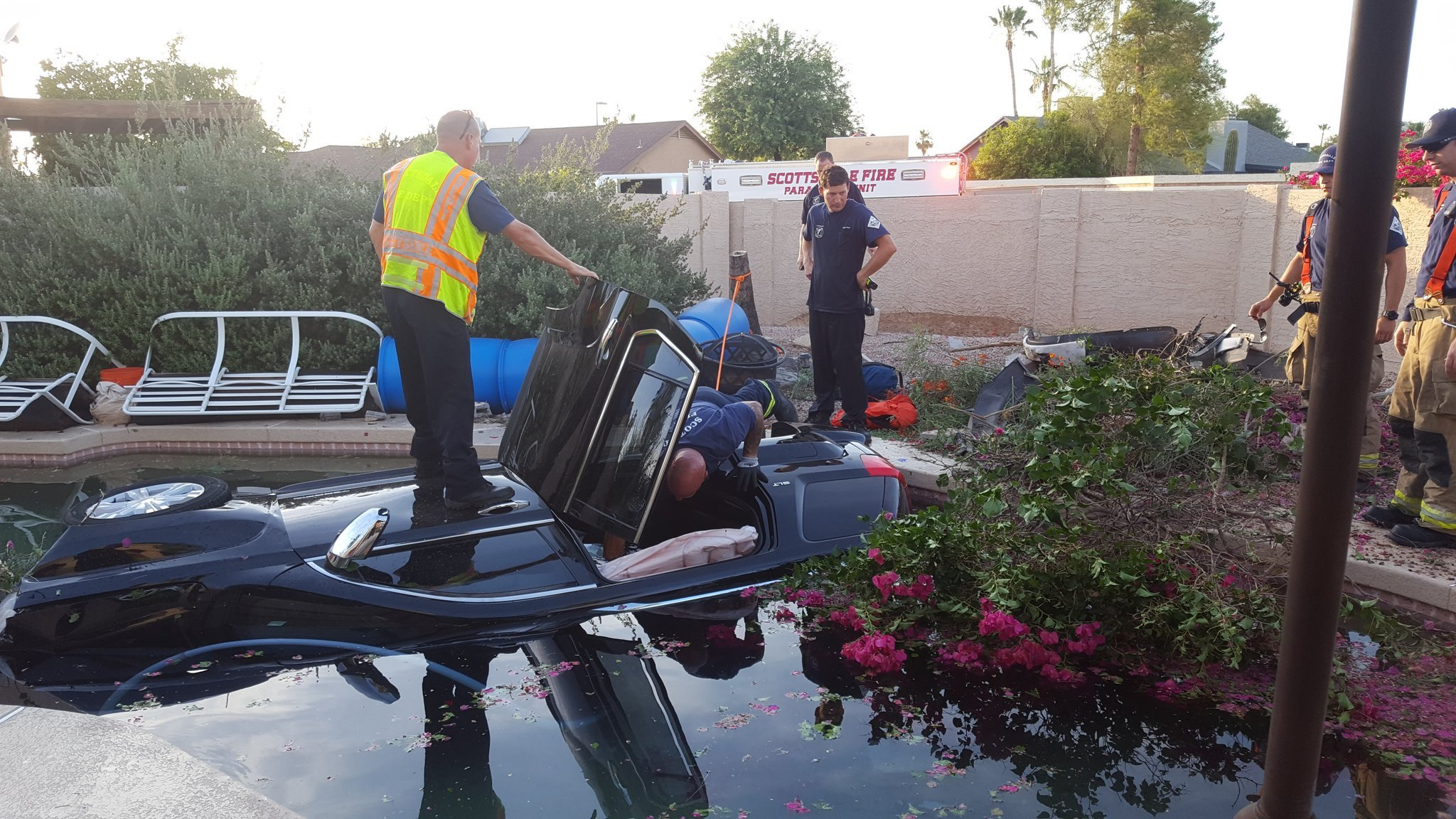 A man was rescued after crashing his SUV into a backyard pool in Scottsdale. (Source: Scottsdale Police Department)
