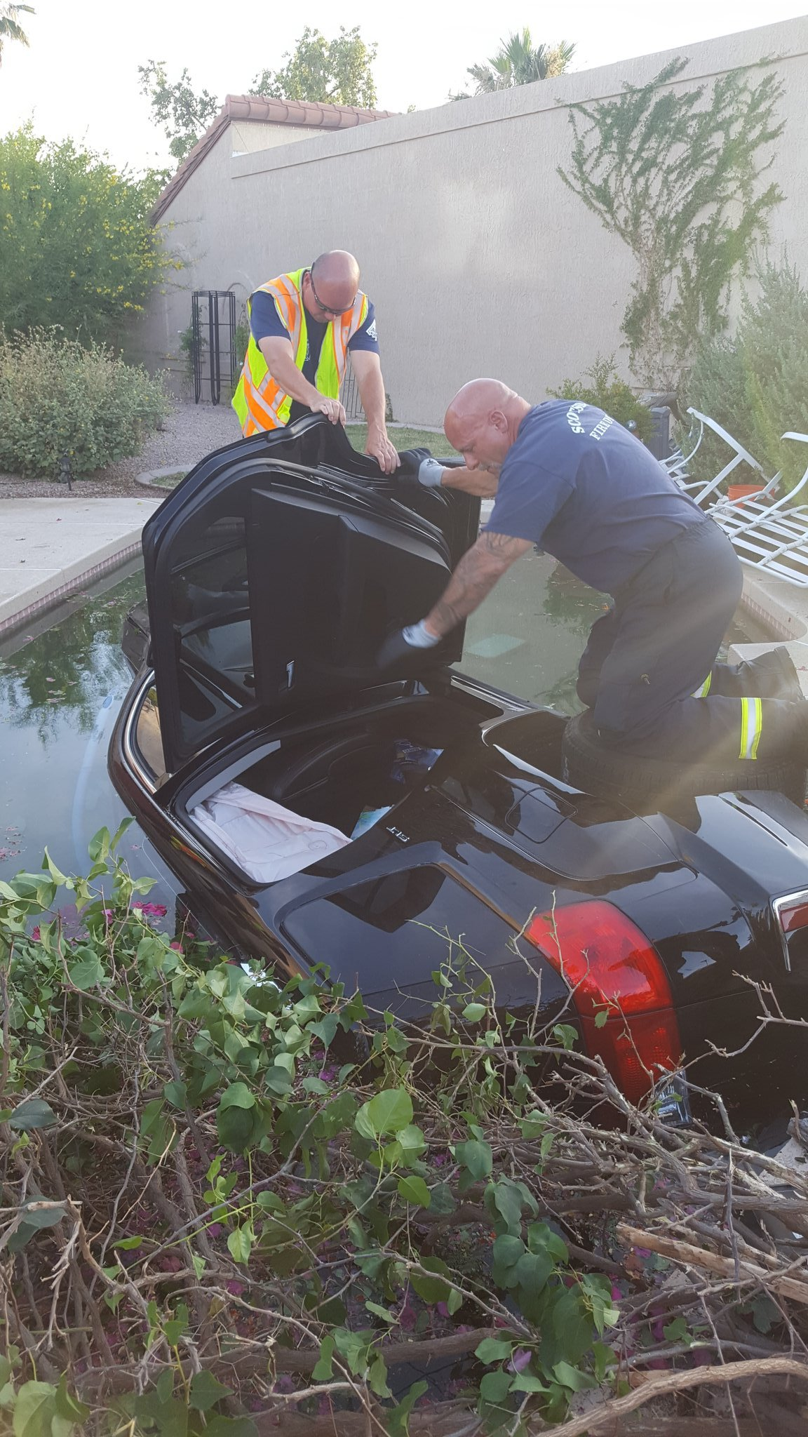 Crews rescued the man from the SUV before it went underwater on its side. (Source: Scottsdale Fire Department)