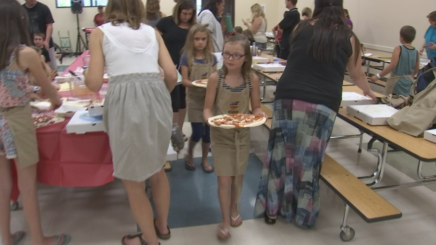 Children lined up to have their pizza's cooked in the oven. (Source: 3TV/CBS 5)