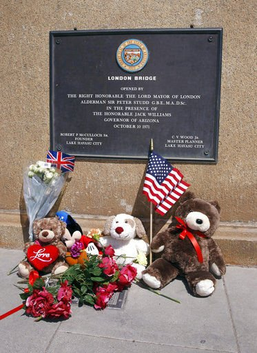 Stuffed animals and flowers adorn a memorial on the Lake Havasu London Bridge to pay respects to the victims (Source: Associated Press)