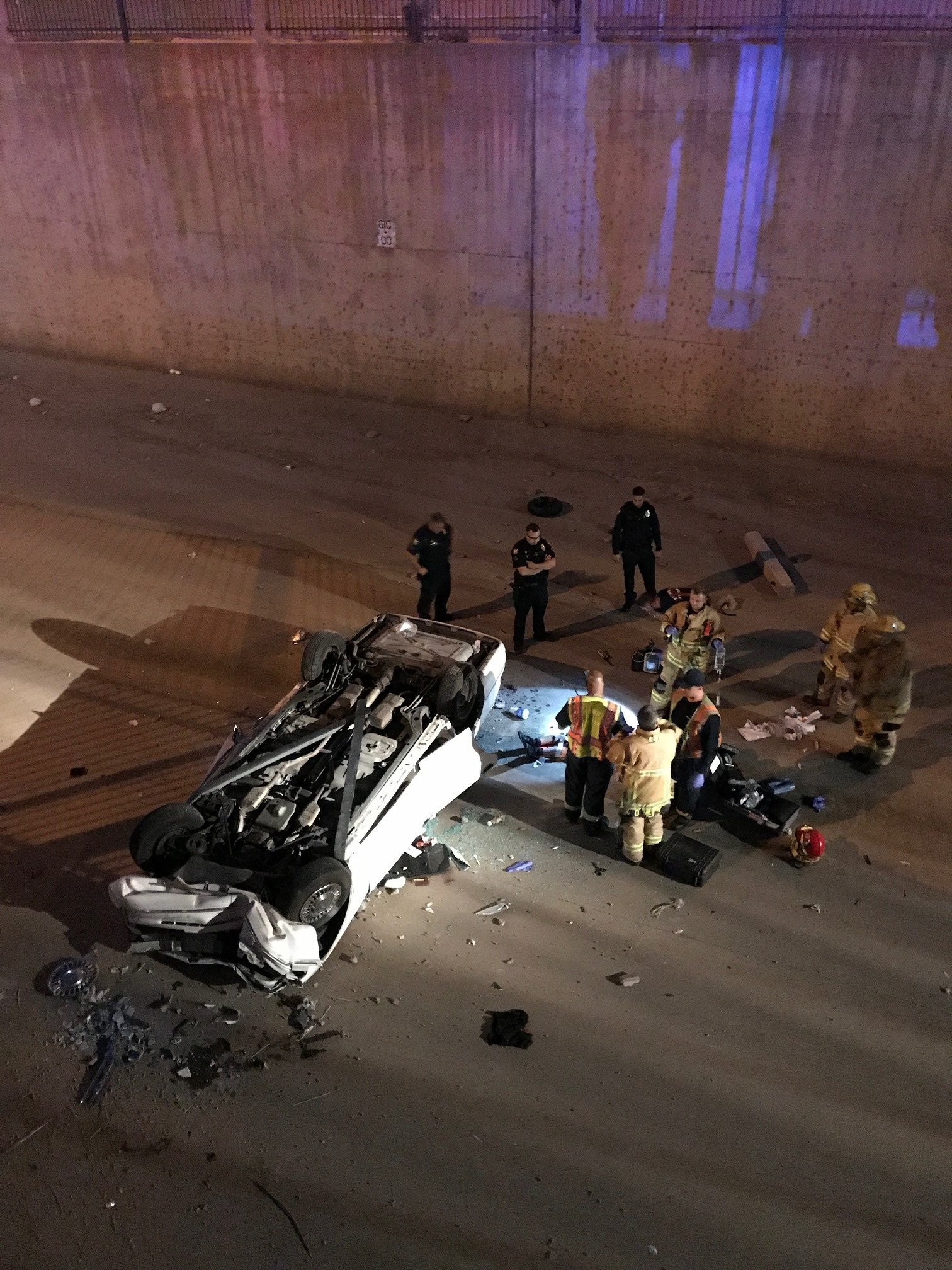 The car landed on its roof. (Source: Phoenix Fire Department)