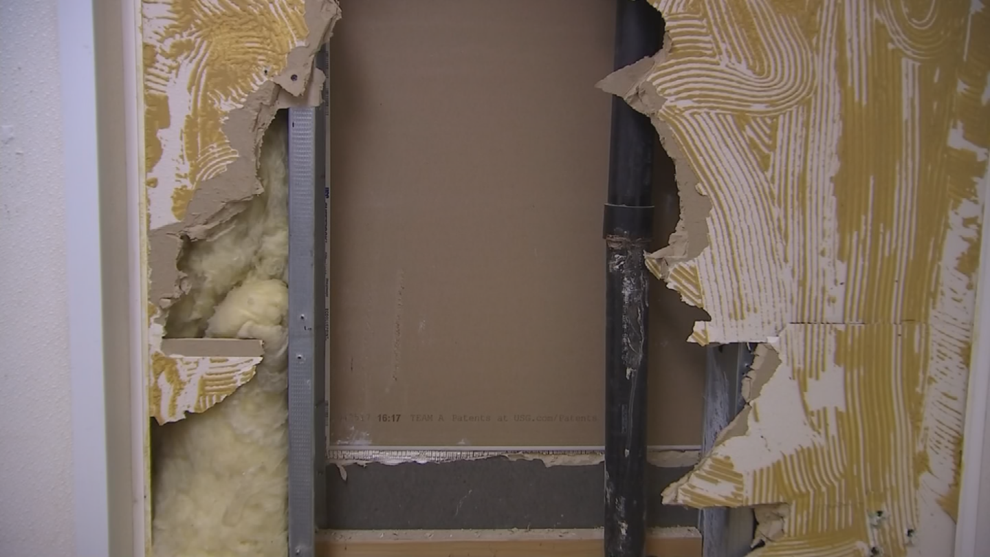 The thief then went through the employee bathroom wall to get to the Verizon store next door. (Source: 3TV/CBS 5)