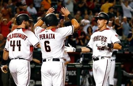 Arizona Diamondbacks' Jake Lamb, right, celebrates his three-run home run against the San Diego Padres with David Peralta (6) and Paul Goldschmidt (44) during the third inning of a baseball game Wednesday, June 7, 2017, in Phoenix. (AP Photo/Ross D. Frank