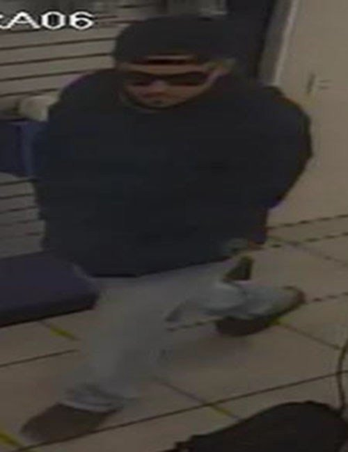 The second suspect, a 20 to 30-year-old man, related to a string of cell phone store armed robberies. (Source: Silent Witness)