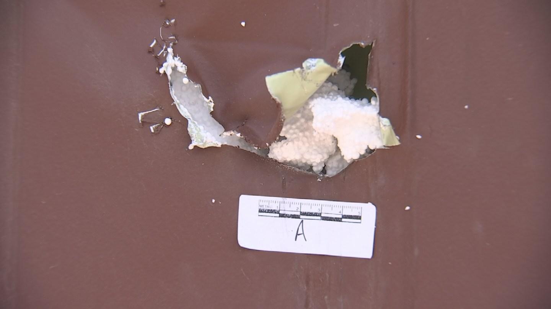 Bullet hole in door of bar (Source: 3TV/CBS 5)