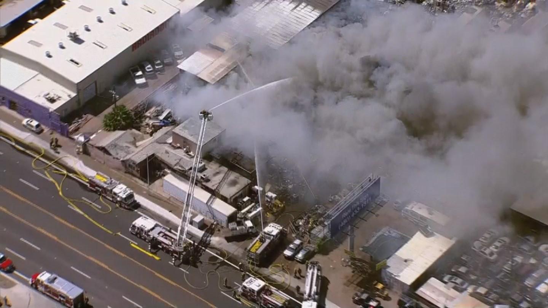 Phoenix fire crews battle a massive junkyard fire near 31st Ave. and Broadway. (12 June 2017) [Source: 3TV/CBS5 news]