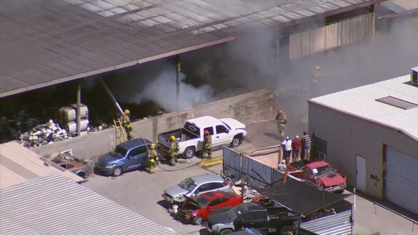 Firefighters working on a junkyard fire in Phoenix Monday afternoon. (12 June 2017) [Source: 3TV/ CBS 5 News]