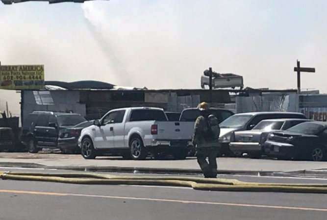 Phoenix firefighters working a junkyard fire Monday afternoon. (12 June 2017) [Source: 3TV/CBS5 News]
