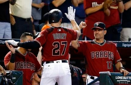 Arizona Diamondbacks' Brandon Drury (27) celebrates his home run against the Milwaukee Brewers with Torey Lovullo (17) and David Peralta (6) during the seventh inning of a baseball game Sunday, June 11, 2017, in Phoenix. (AP Photo/Ross D. Franklin)