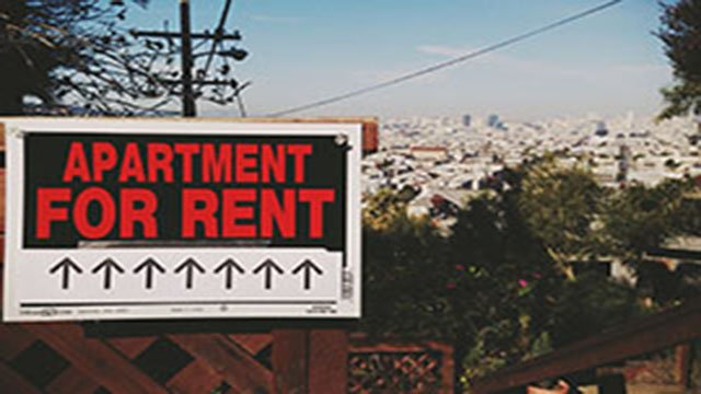 At the current Arizona minimum wage of $10 an hour, a worker would have to put in 70 hours a week to rent a two-bedroom home without putting more than 30 percent of income toward rent. (Source: Markus Spiering/Creative Commons)