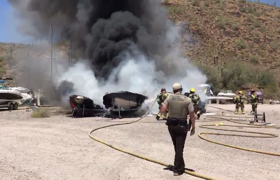 Fire crews put out boats that caught fire at Lake Pleasant Friday. (16 June 2017) [Source: 3TV/CBS5 News]