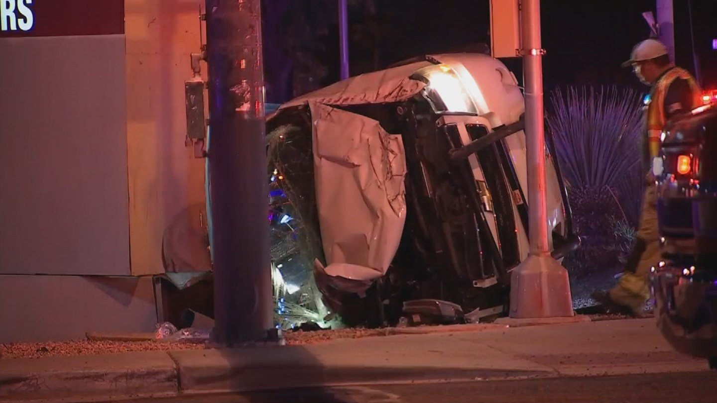 Phoenix fire officials say one of the police officers, a30-year-old woman, received injuries to her hand after she tried to help pull another officer out of his vehicle after a rollover collision.(Source: 3TV/ CBS 5)