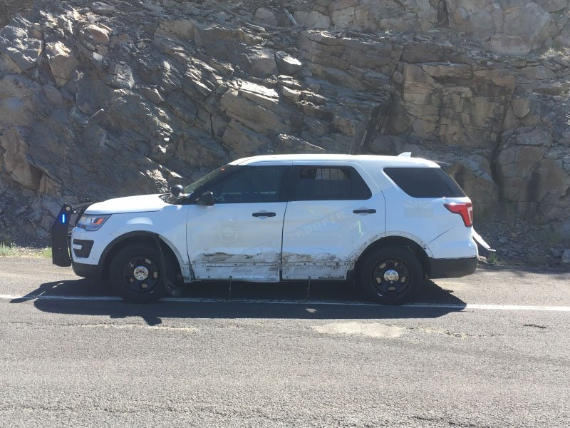 The patrol vehicle was disabled from the repeated hits. (Source: Arizona Department of Public Safety)