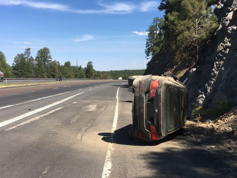 The BMW hit a rock embankment and rolled over. (Source: Arizona Department of Public Safety)