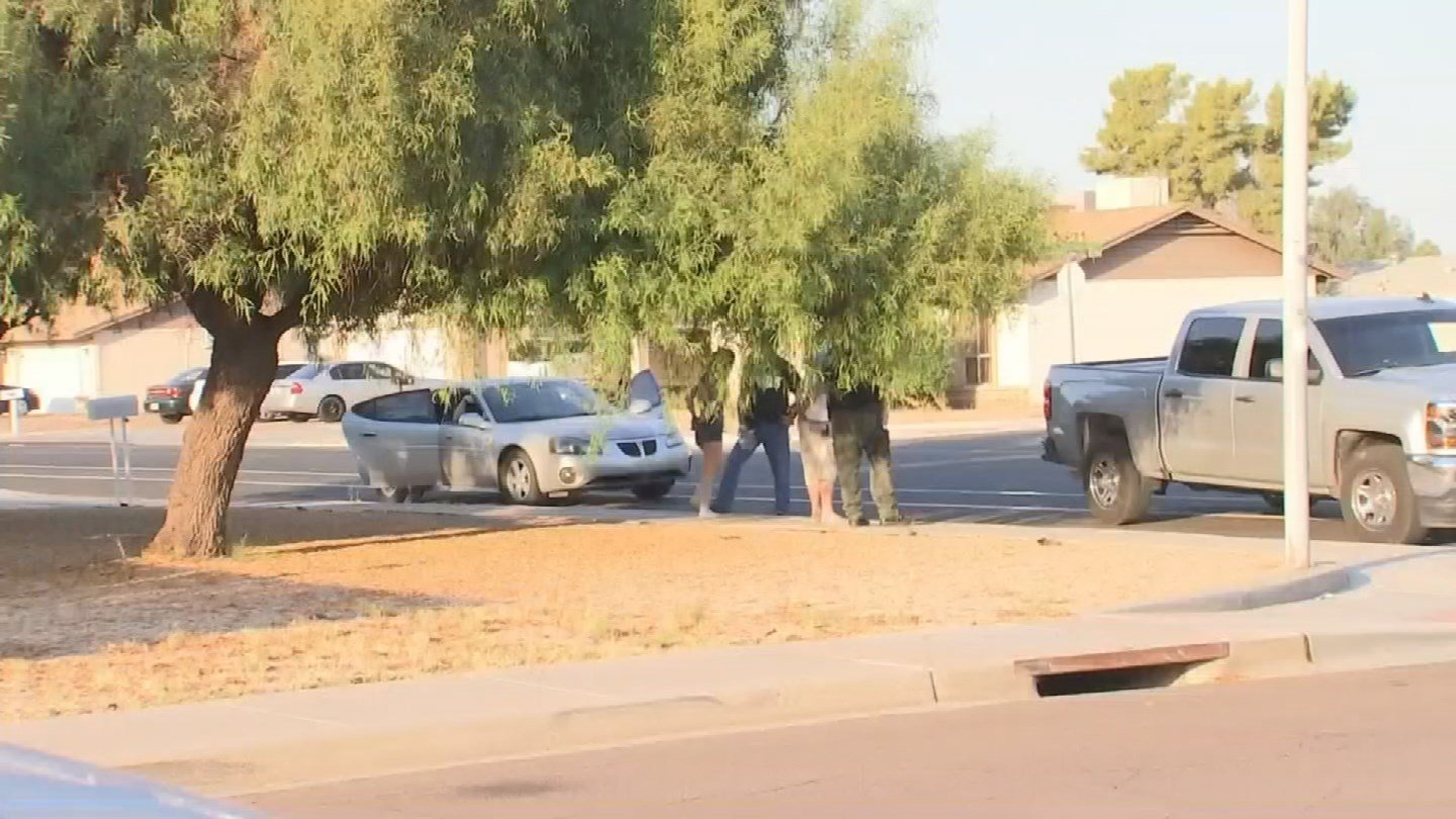 Two people were brought out in handcuffs. (Source: 3TV/CBS 5)