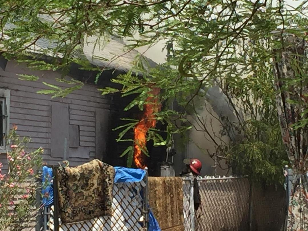 Fire fighters fight flames at a home near 11th street and Moreland. (19 June 2017) [Source: 3TV/CBS5 News]