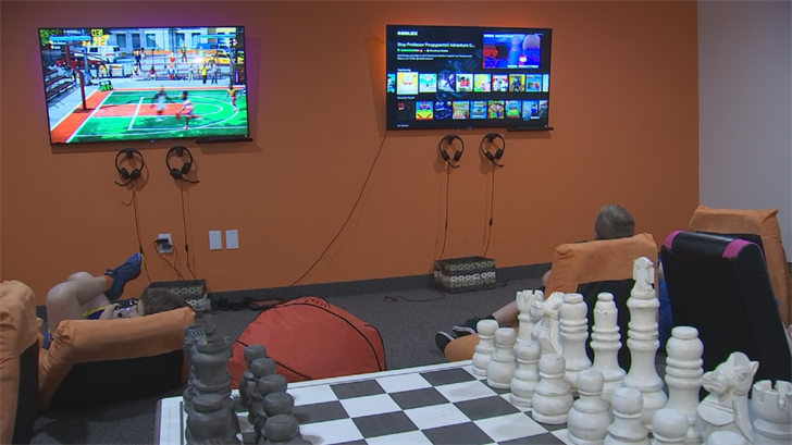 The multi-level facility offers a club room complete with the latest video games, a relaxation room where the lights dim and massage chairs buzz and a board room. (Source: 3TV/CBS 5)